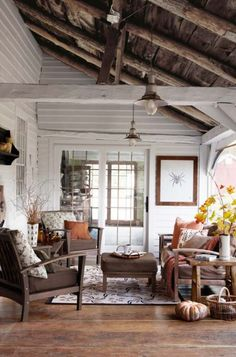 cabin, living rooms, exposed beams, white walls, rustic look, wood ceilings, enclosed porches, wood beams, sunroom