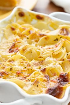 Out Standing ~ Scalloped Potato Gratin ~ recipe ~ cream,  fresh thyme, garlic cloves, ground nutmeg, unsalted butter, parmesan cheese...