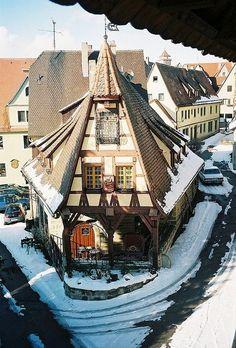 Bavarian corner house - Rothenburg, Germany.  This town is enclosed in a wall-very cute.