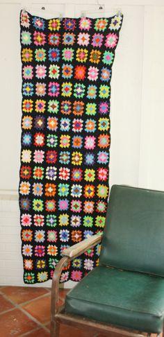 want to make a black granny square sumpin sumpin  Cool> Neon on Black -  Granny Square Afghan - Throw - Circa 1970s. via Etsy.
