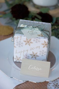 holiday wrapping // photo by Modern Kids Photography // http://ruffledblog.com/silver-and-gold-nye-party
