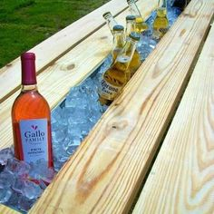 Photo: This is a picnic table made out of salvaged wood.  The ice chest in the middle is a recycled rain gutter that now keeps your picnic beverages cold.