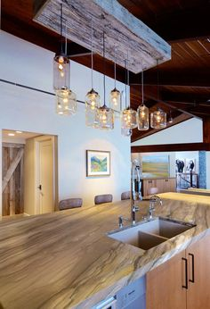Awesome lights! Contemporary Ranch Interior Design by Johnson & Associates