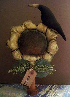crow sitting on sunflower