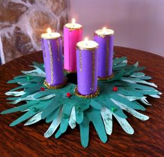 ADVENTuresome Family Fun » Catholic Sistas. How to make an Advent wreath out of a paper plate, construction paper, toilet paper rolls, LED tea lights, and a little glitter. This would be a perfect Advent craft for my class!