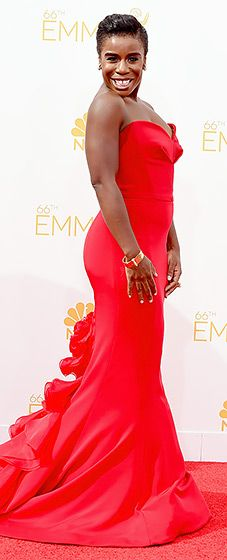 OITNB's Uzo Aduba looked elegant in a strapless red gown with a dramatic train at the 2014 Emmys.
