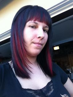 First of all she looks pissed, but she isnt. Miss Ashley Dunn Loves her Black hair with Red color blocking. SO fun and easy and so healthy on your hair