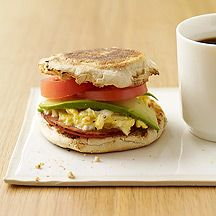 Image of an egg sandwich with bacon avocado and tomato