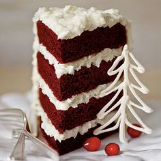 Red Velvet Cake with Coconut-Cream Cheese Frosting | This cake bakes best in four pans. If you need additional pans, use 8-inch aluminum foil disposable pans. Just be sure to place them on a baking sheet for stability. #Christmas Recipes