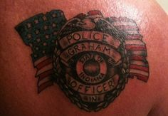 This Indiana detective's name (Graham) is shown on a badge with the backdrop of a tattered American flag. - www.policemag.com - #police