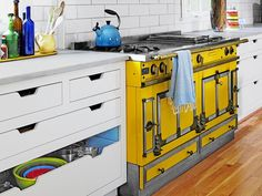 Can you believe someone left this yellow stove in the basement? Now it's the centerpiece of this bright kitchen. (http://www.hgtv.com/decorating-basics/find-design-inspiration-for-the-whole-house/pictures/index.html?soc=Pinterest)