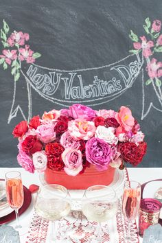 Valentine's Day centerpiece, photo by Obscura Photoworks http://ruffledblog.com/cupids-arrow-valentines-day-inspiration #centerpieces #pink #valentinesday