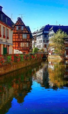 Strasbourg, in Alsace, France  A most beautiful city bordering Germany with the Ill River winding through it.  The river walkway is dotted with tiny shops, galleries, and bistros.  Everywhere you look there are endless windowboxes with fabulous flowers overflowing.
