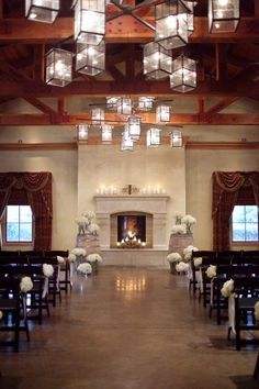 love the wide aisle, the fireplace, and the simple decorations (barrels!) around the altar
