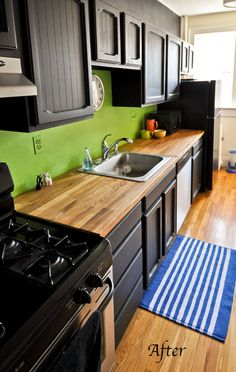 I never expected to like black kitchen cabinets, but with the butcher block counters and the black appliances, it works, no?