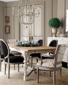 """Frison"" Dining Furniture, French Script Armchair, & Black Linen Chairs  $799.00-1,999.00  Wood dining table features a brushed elm top and decorative turned legs. Legs and stretcher have a hand-painted ""baker's flour"" finish. 92""W x 46""D x 30""T; extends to 118""W with 26"" leaf.    Armchair has black French script writing on linen-colored fabric, brass nailhead trim, and a hand-carved frame. Fabric is cotton/rayon blend; frame is hardwood solids with an aged driftwood finish."