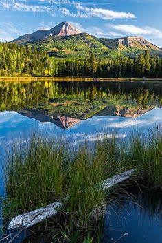 Engineer Mountain reflecting in Boyce Lake, Colorado; photo by Gary Schmickle