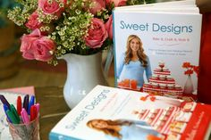 """We're giving away an AUTOGRAPHED copy of """"Sweet Designs"""" to one lucky fan, along with a set of our super-cute party glasses! Amy Atlas and FE...what could be better?!    Rules:  To enter, simply tell us WHY you want a copy of """"Sweet Designs""""! Posts can be made on Facebook, Twitter, or even Pinterest...just remember to tag both @Fishs Eddy and @Amy Atlas on your post, and don't forget to use the #sweetdesigns hashtag! The winner will be announced on Friday, May 11th, 2012. GOOD LUCK!"""