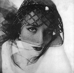 Shadow cloche [a hat that's a veil, a veil that's a hat] by John-Frederics photo by Irving Penn for Vogue Feb. 1950
