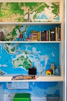 Map lined book shelves. From the Living With Kids Home Tour featuring Kate Oppenhuis.