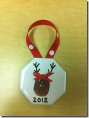 Thumb print reindeer ornament using bathroom tile