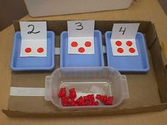 Structured counting task: student matches bears to dots by velcro.  Set up to be used at teacher work or as independent task.