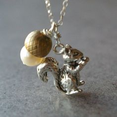 A squirrel and acorn necklace.