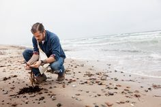 #nordicdesigncollective Lars Williams, the head of research and development at the Nordic Food Lab, forages for seaweed on a nearby beach// photo by The Selby for T Magazine.
