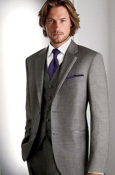 groomsmen (freeman) gray suit, purple tie and pocket square. gray vest        Calvin Klein 1212  Grey, notch lapel, two-button tuxedo, with grey satin trim