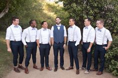 suspenders for the groomsmen and vest for the groom! photo by Katrina Louise - http://ruffledblog.com/secluded-garden-estate-wedding/