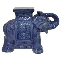 Add an artful touch to your living room seating group or breakfast nook with this charming ceramic stool, showcasing an elephant silhouette and blue finish.