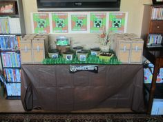Favor table. Brown table cloth, grass placemat ordered online, favor bags, green buckets of different kinds of rocks (all from Flower Factory--iron, coal, gold, lapis lazuli, redstone