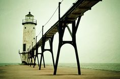 Manistee Light by Joy St. Claire.  Manistee Pierhead, Michigan #lighthouse #bridge #beach #iwtgtt
