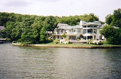 """Don't leave the resort without taking the entertaining cruise on """"Lake of the Ozarks"""". This is one of the many huge homes on the lake."""
