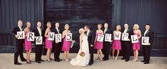 Wedding Party holds letters of couple's name