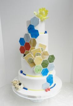 A SETTLERS OF CATAN WEDDING CAKE, COMPLETE WITH DAPPER SHEEP