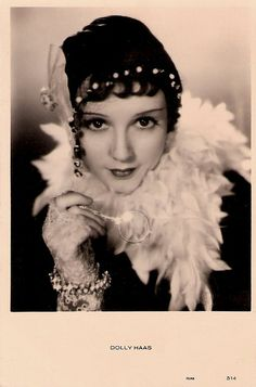 """""""Stage and screen actress Dolly Haas (1910-1994) was popular in the 1930's as a vivacious, red-haired gamine often wearing trousers in German and British films."""""""