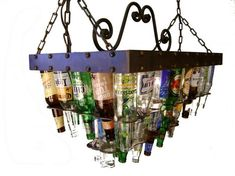 """This two tier beer bottle chandelier is a smaller version of our classic pool table model. It holds 36 empty beer bottles (not included), it also features 9/16"""" diameter faceted rivets around the top 2"""" band."""