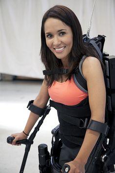Tamara Mena, paraplegic shows off her beautiful smile as she stands up and walks, using eLEGS, bionic exoskeleton, by BerkeleyBionics