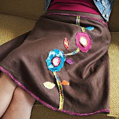 This is always a good way to spruce up an old skirt...if you get bored easily with your clothes but KNOW you don't want to buy new ones try this out!