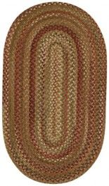 Braided rug in rage and red. Oval rug great for a traditional style or southwest style home.