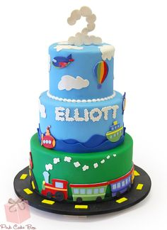 Elliott's 2nd birthday cake! We created this cake to match the theme and invitation for Elliott's second birthday. The top tier includes a plane, hot air balloon and helicopter flying against sky blue fondant and white puffy clouds.