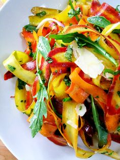 Rainbow Carrot Ribbon Salad Ingredients:  rainbow carrot ribbons baby arugula Parmigiano Reggiano ribbons slivered red onion fresh parsley fresh basil toasted pine nuts, optional salt and pepper to taste light vinaigrette