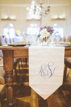 #Monogram Table Runner | See the wedding on SMP: http://www.StyleMePretty.com/2013/08/14/minnesota-winter-wedding-from-paper-antler-photography/  Paper Antler Photography