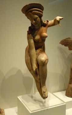 Terracotta  Aphrodite removing her sandal.      Pella. Late 4th – early 1st  BC.