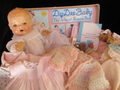 Vintage Effanbee Dy-Dee Doll in her box with layette.