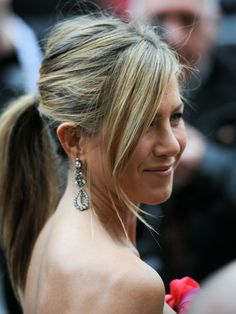 2010  Jen ditched her signature blowout for a tousled pony with face-framing bangs at the France premiere of The Bounty Hunter.