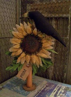 crow with burlap sunflowers