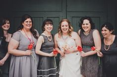 grey bridesmaid dresses, photo by Carina Skrobecki http://ruffledblog.com/seattle-art-gallery-wedding #bridesmaiddresses