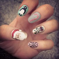 signs of #christmas and the #winter #holiday season: #santa, #penguin, #candycane, #mistletoe, #snowflake